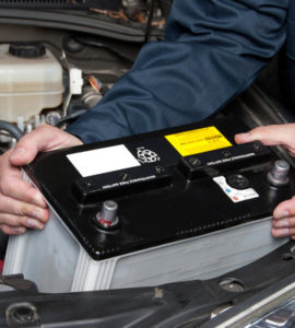 service-technician-with-new-car-battery-port-alberni